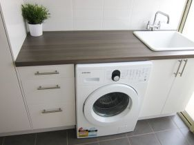 Classy laundry room update with first class finishing to make a functional room that looks elegant and stylish Image 28