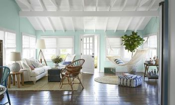 Coastal cottage living area with pure bright schemes outlooking vast sea view giving a complete beach style home Image 10