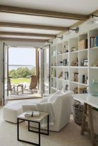 Coastal cottage living area with pure bright schemes outlooking vast sea view giving a complete beach style home Image 11