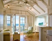 Coastal cottage living area with pure bright schemes outlooking vast sea view giving a complete beach style home Image 15
