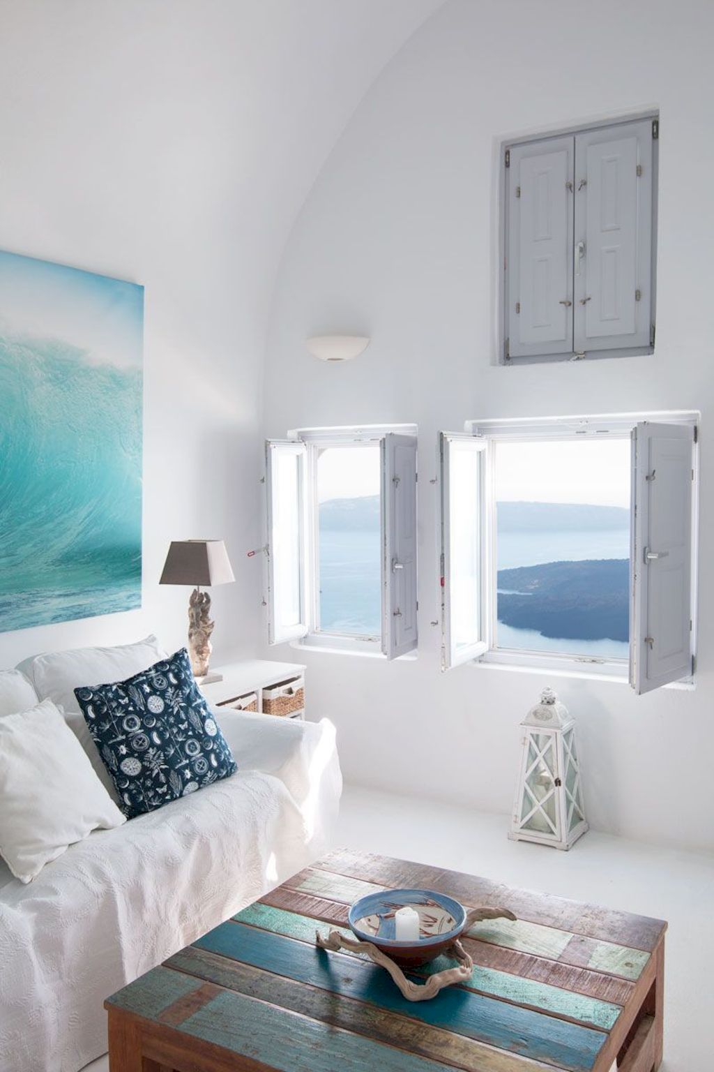 Coastal cottage living area with pure bright schemes outlooking vast sea view giving a complete beach style home Image 27