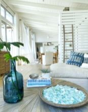 Coastal cottage living area with pure bright schemes outlooking vast sea view giving a complete beach style home Image 28