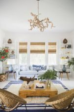 Coastal cottage living area with pure bright schemes outlooking vast sea view giving a complete beach style home Image 3