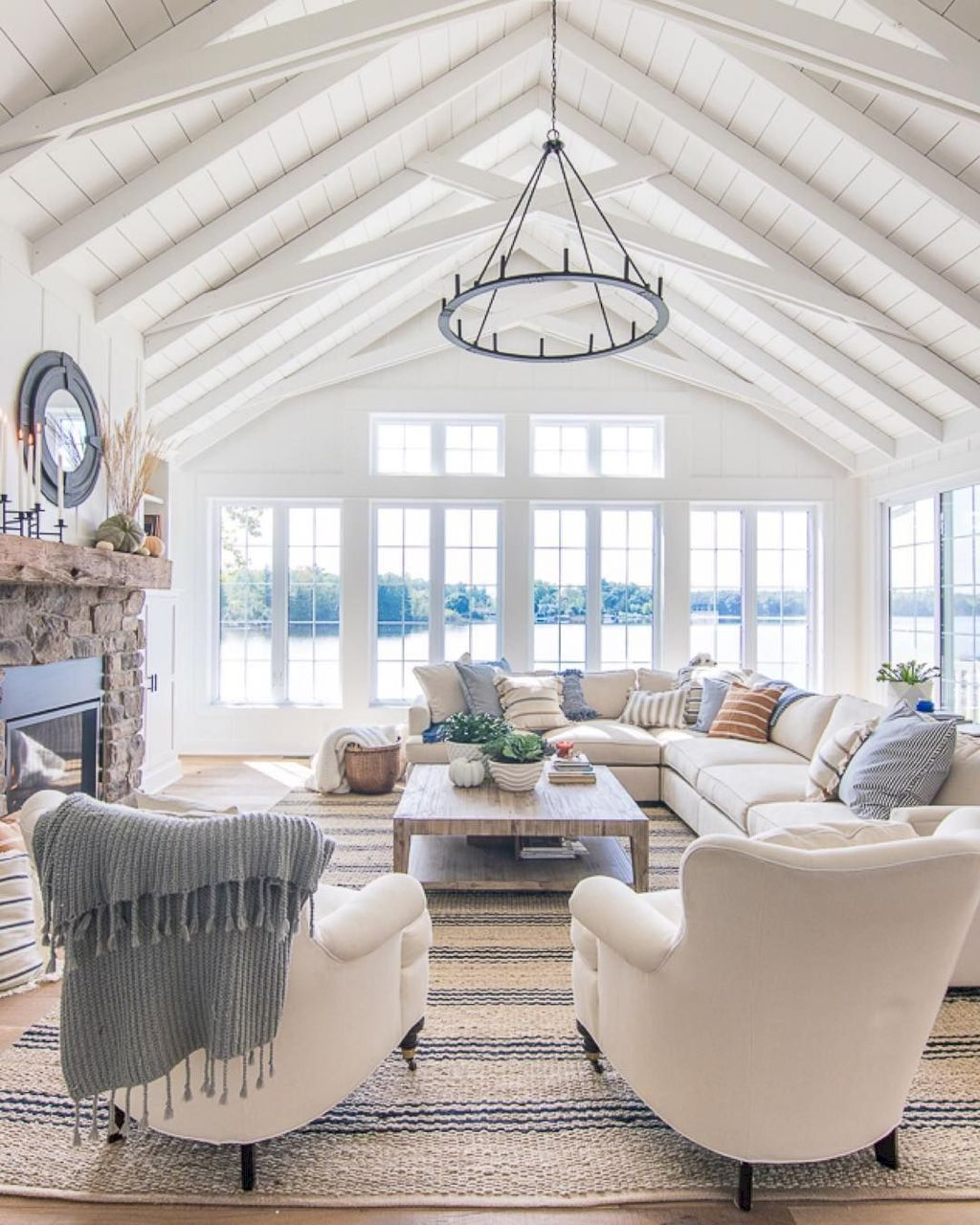 Coastal cottage living area with pure bright schemes outlooking vast sea view giving a complete beach style home Image 8