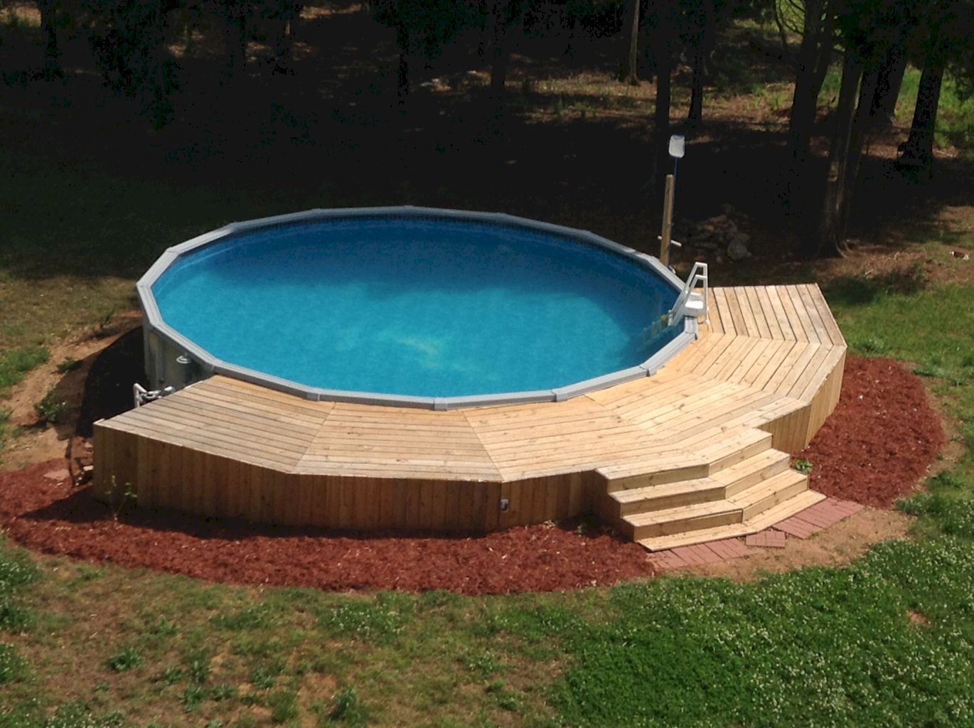 Simple pool designs built above ground designed with cheap materials for simple outdoor relieves Image 20