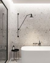 Jazzy Terrazzo Tiles Giving Simple Bathroom a Spa-like Finishing