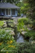Best water garden style rich of natural accents with stones and aquatic plants compositions Image 8