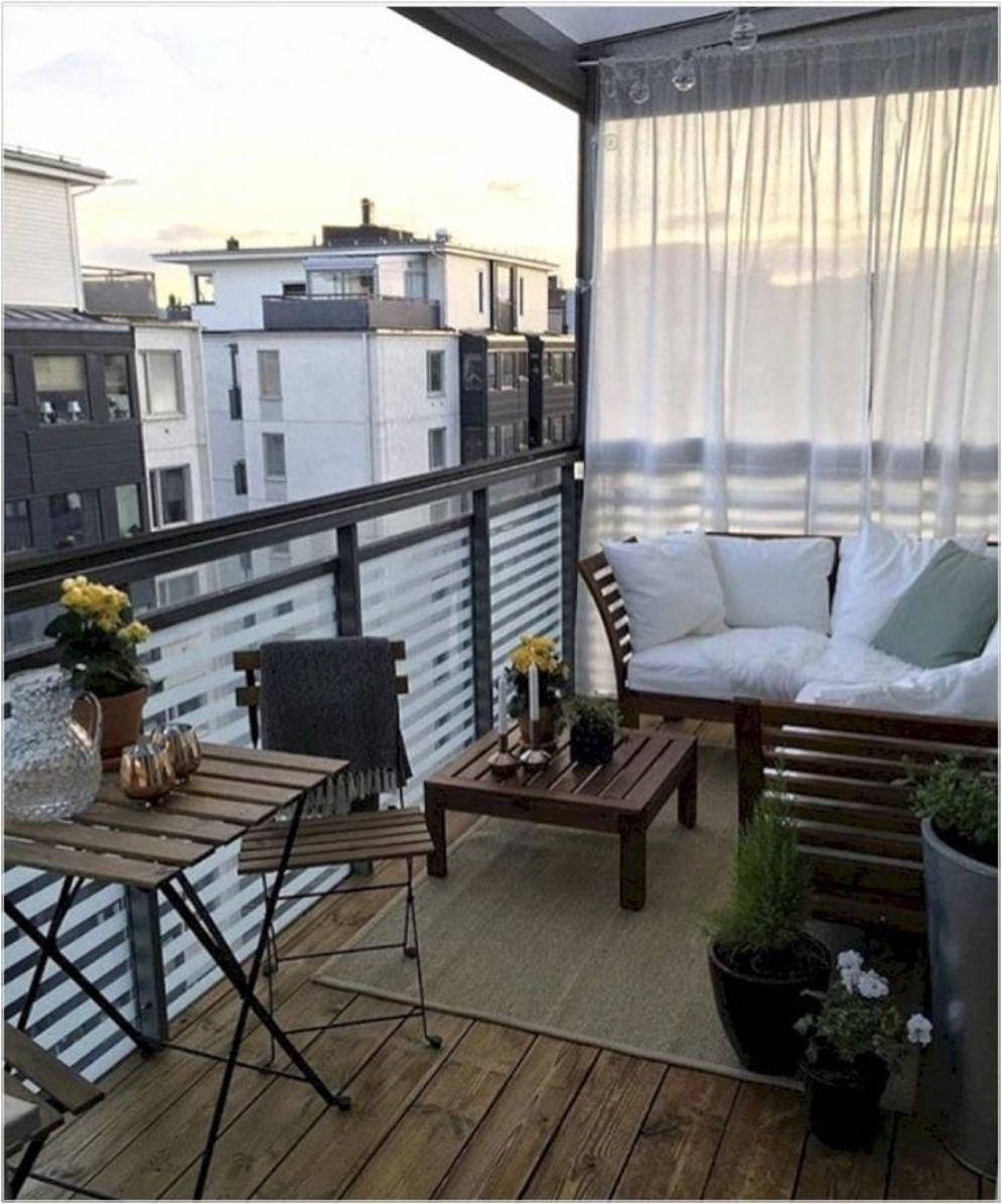 Brilliant apartment balcony ideas converted into cozy living space Image 8