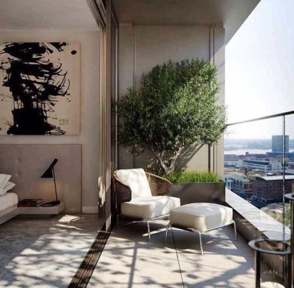 Clever apartment balcony conversion maximizing small space into functional living area Image 20