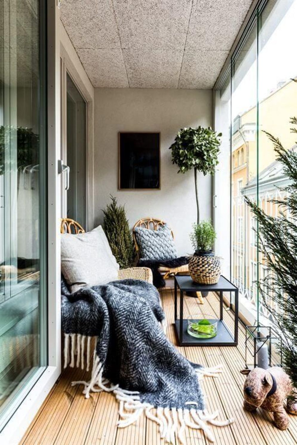 Clever apartment balcony conversion maximizing small space into functional living area Image 24