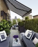 Clever apartment balcony conversion maximizing small space into functional living area Image 25