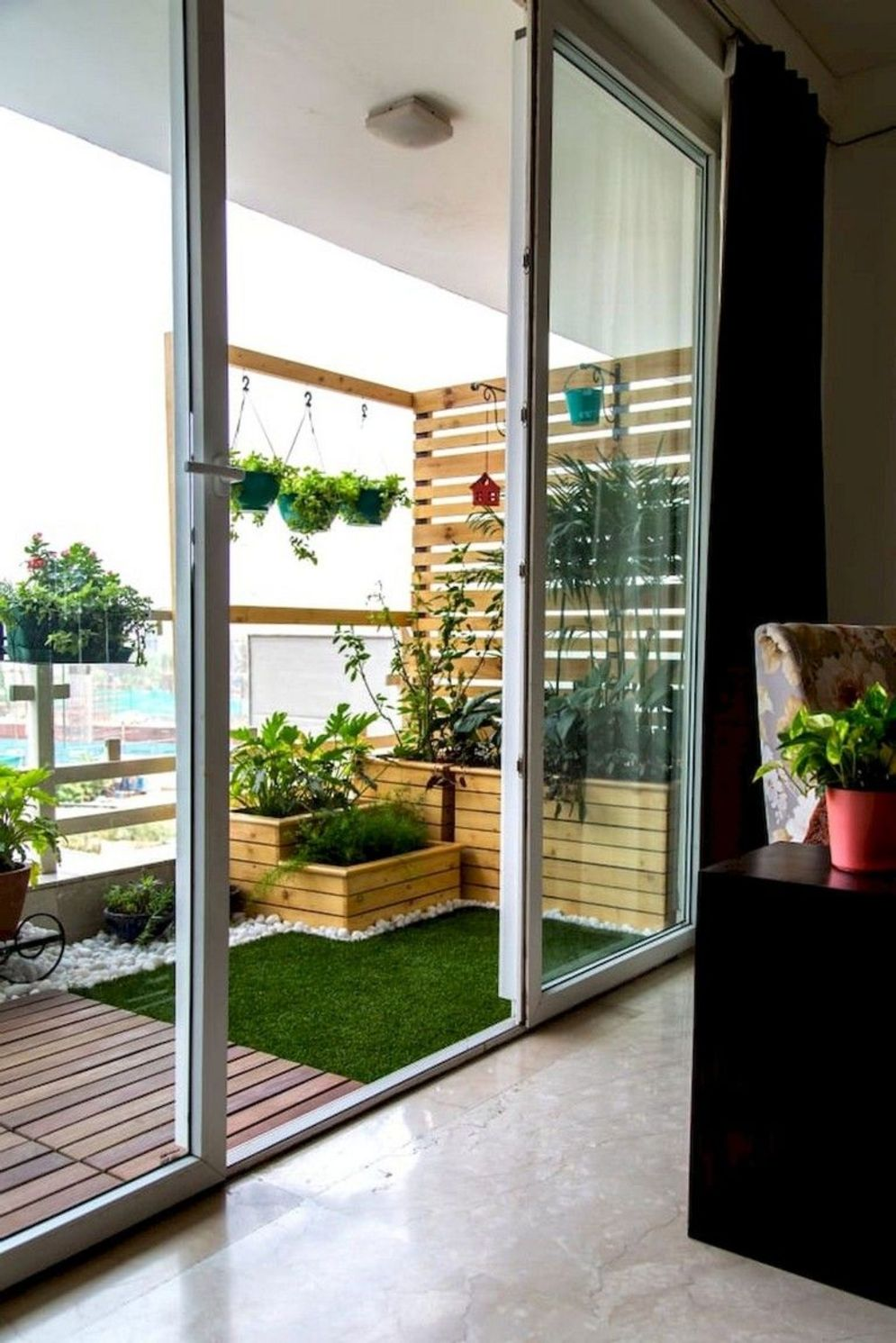 Clever apartment balcony conversion maximizing small space into functional living area Image 38