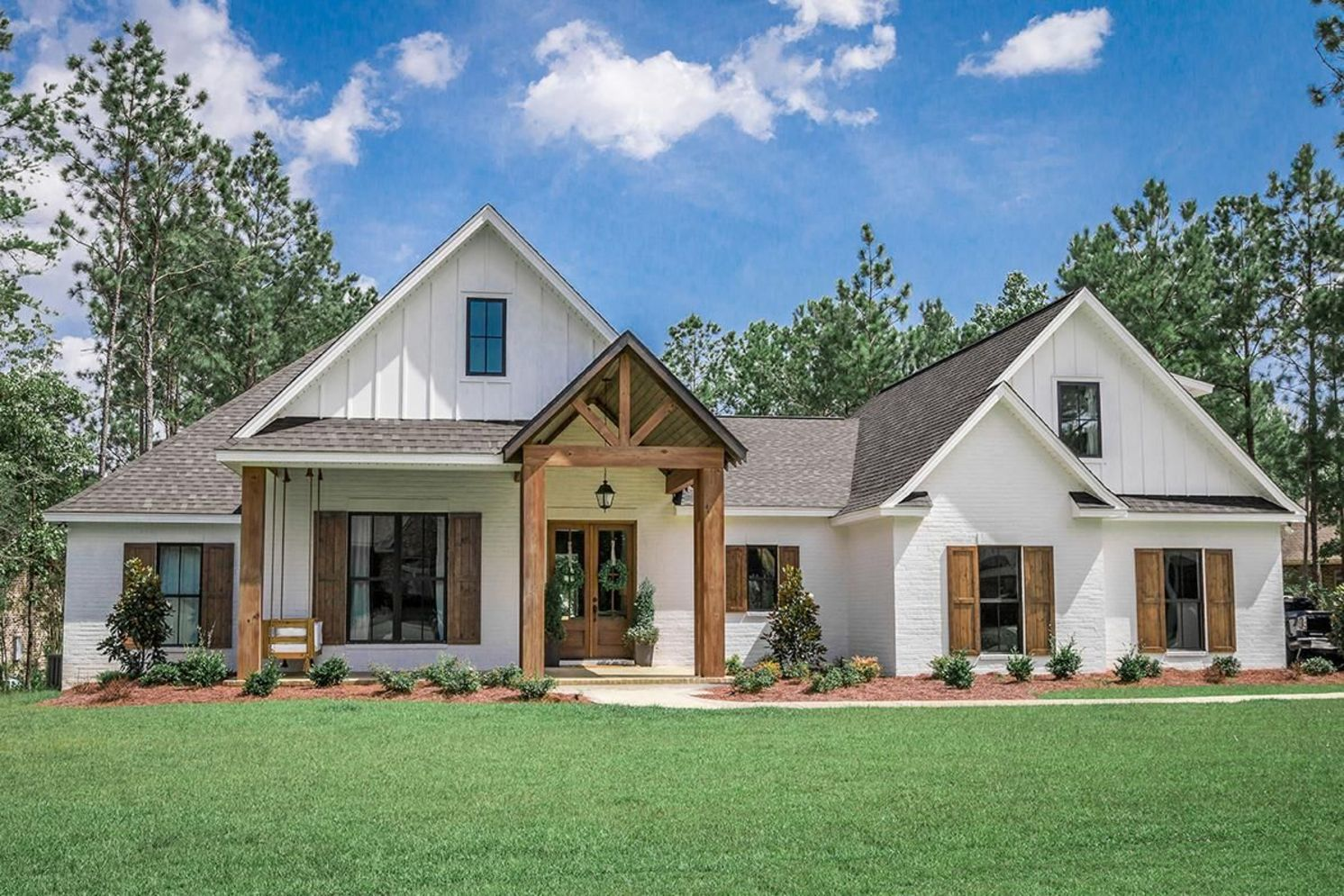 Countryside house with modern Farmhouse exterior design bringing up the traditional style in new classy look Image 23
