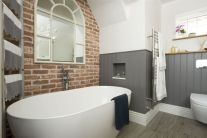 Cozy bathroom update adapting brick wall accents showing charm and friendly finish Image 1