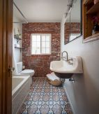 Cozy bathroom update adapting brick wall accents showing charm and friendly finish Image 13