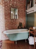 Cozy bathroom update adapting brick wall accents showing charm and friendly finish Image 15