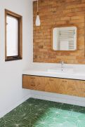 Cozy bathroom update adapting brick wall accents showing charm and friendly finish Image 20