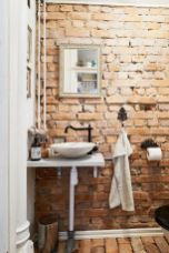 Cozy bathroom update adapting brick wall accents showing charm and friendly finish Image 7