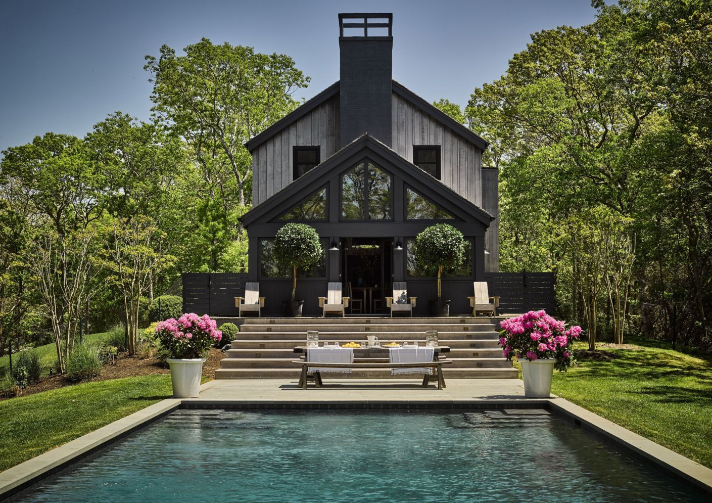 Modern house with new farmhouse exterior design pulling out country charm and warm welcoming display Image 35