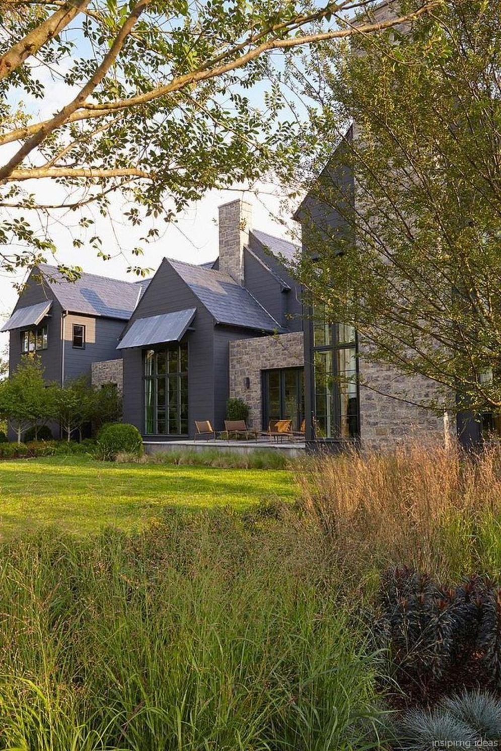 Modern house with new farmhouse exterior design pulling out country charm and warm welcoming display Image 42