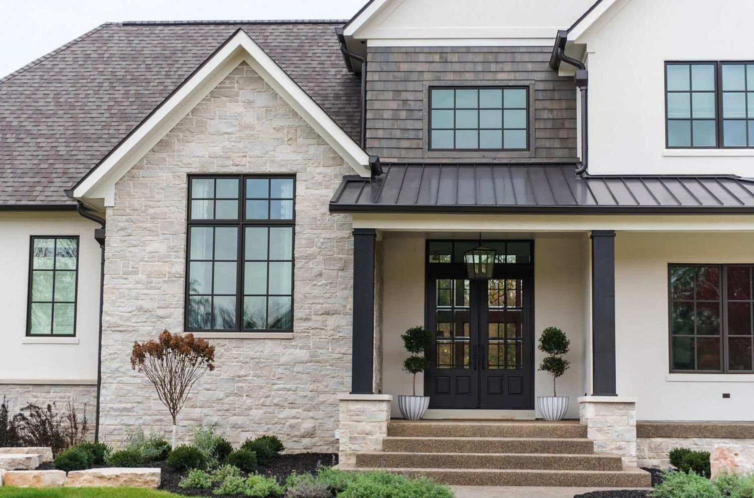 Modern house with new farmhouse exterior design pulling out country charm and warm welcoming display Image 45