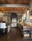 Rustic cabin kitchen designs showing warm wooden structure in earthy natural palettes Image 1