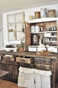 Rustic cabin kitchen designs showing warm wooden structure in earthy natural palettes Image 11