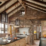 Rustic cabin kitchen designs showing warm wooden structure in earthy natural palettes Image 18