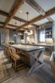 Rustic cabin kitchen designs showing warm wooden structure in earthy natural palettes Image 3