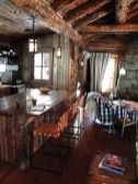 Rustic cabin kitchen designs showing warm wooden structure in earthy natural palettes Image 4