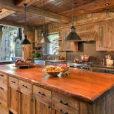 Rustic cabin kitchen designs showing warm wooden structure in earthy natural palettes Image 9