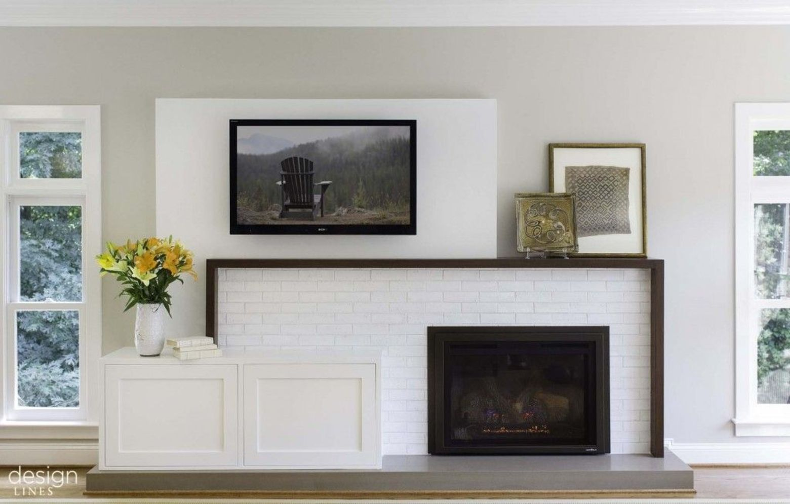 Amazing interior design showing enclosed log burning fireplace along with savvy TV wall Image 10