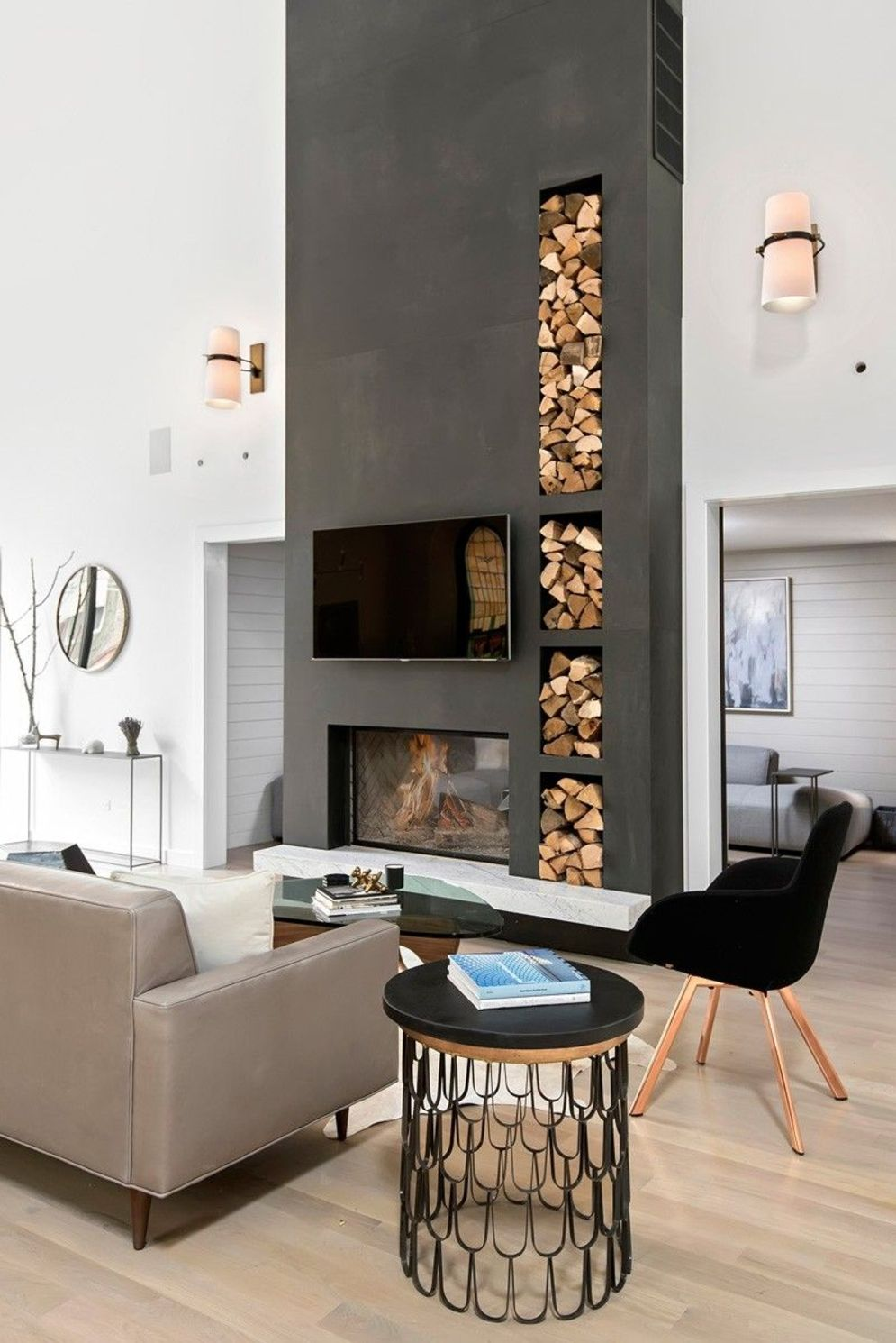 Amazing interior design showing enclosed log burning fireplace along with savvy TV wall Image 2
