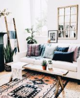 Artful interior style showcasing eclectic Bohemian display with ethnic rugs as decoration Image 22