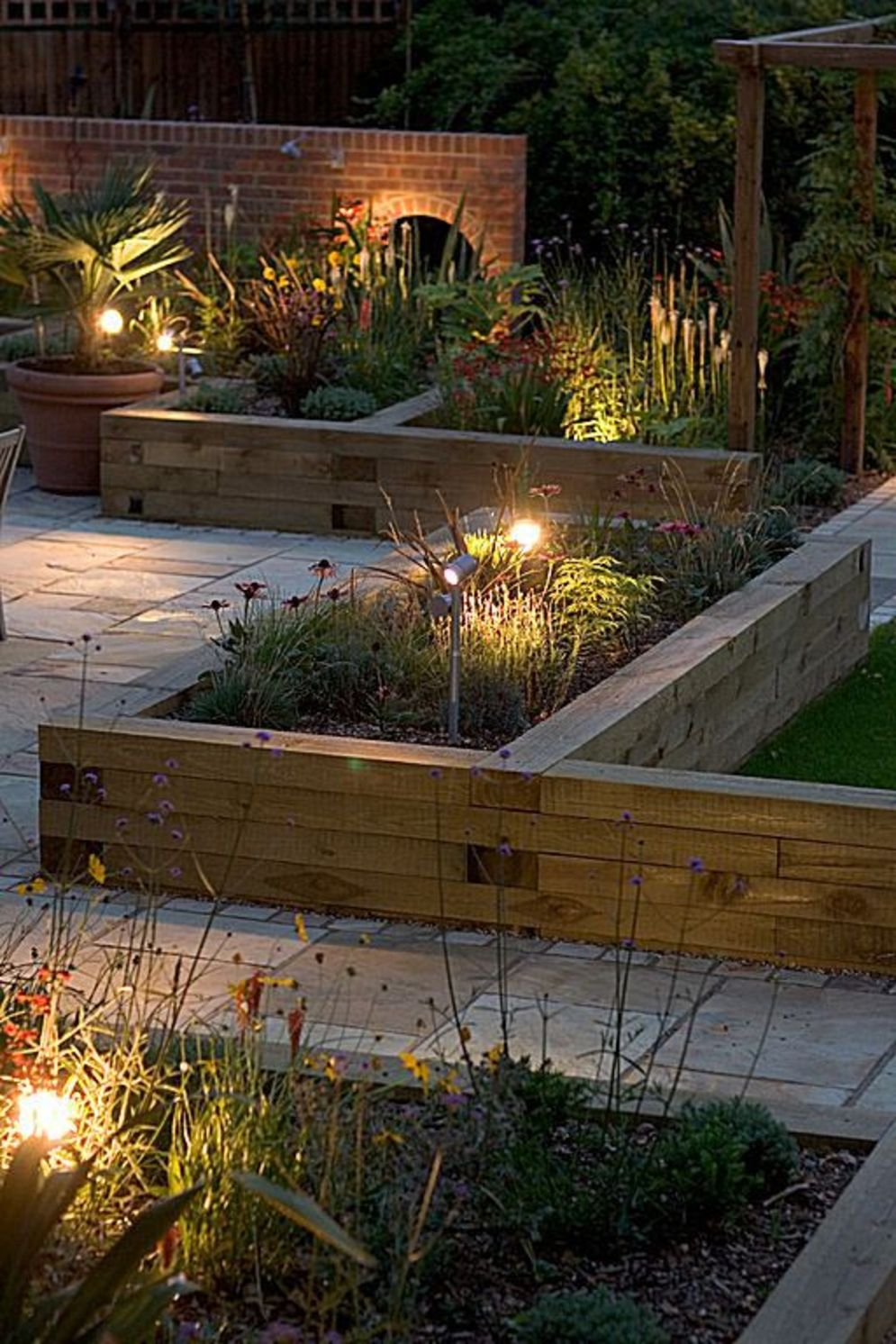Beautiful garden lighting ideas with ground level ambient light giving luxurious resorts look Image 13