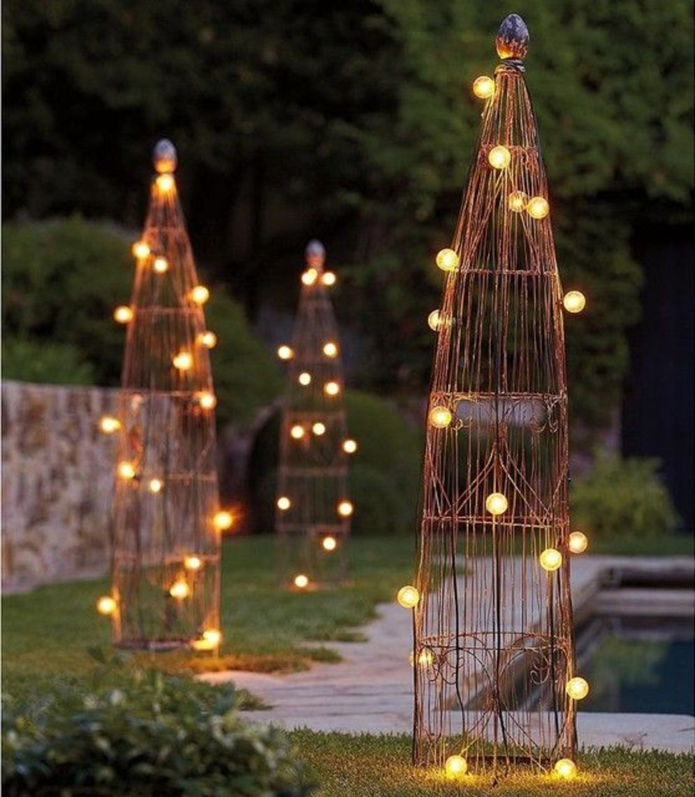 Beautiful garden lighting ideas with ground level ambient light giving luxurious resorts look Image 21