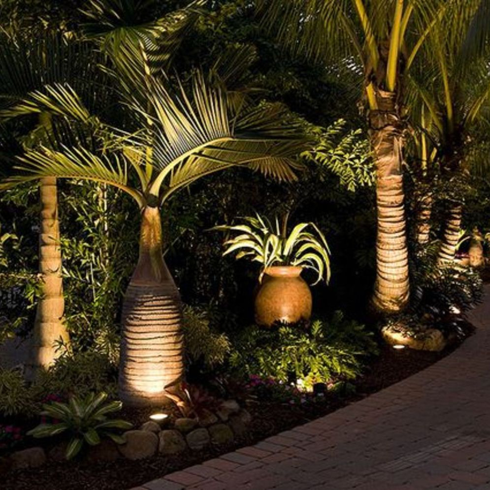 Beautiful garden lighting ideas with ground level ambient light giving luxurious resorts look Image 27