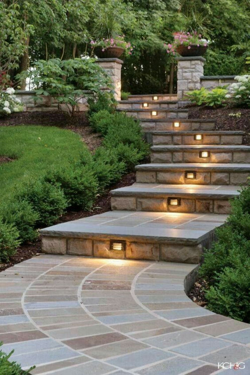 Beautiful garden lighting ideas with ground level ambient light giving luxurious resorts look Image 30