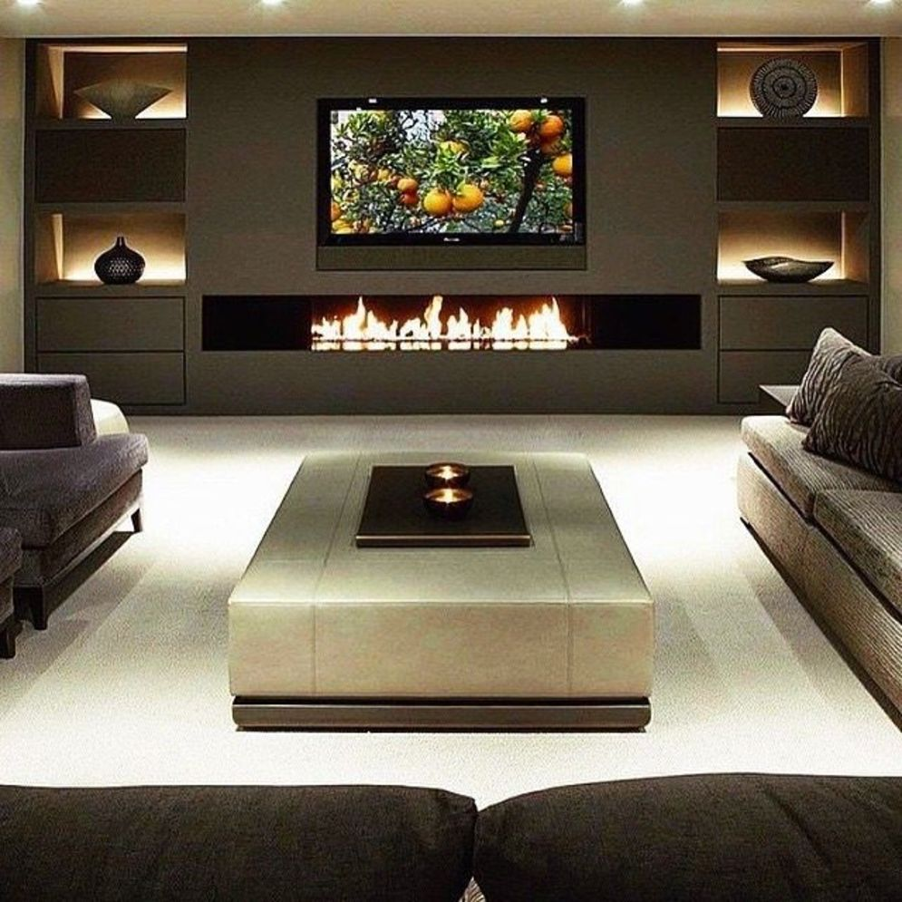 Efficient living room decoration giving exotic combination of gas burning fireplace and TV wall Image 17