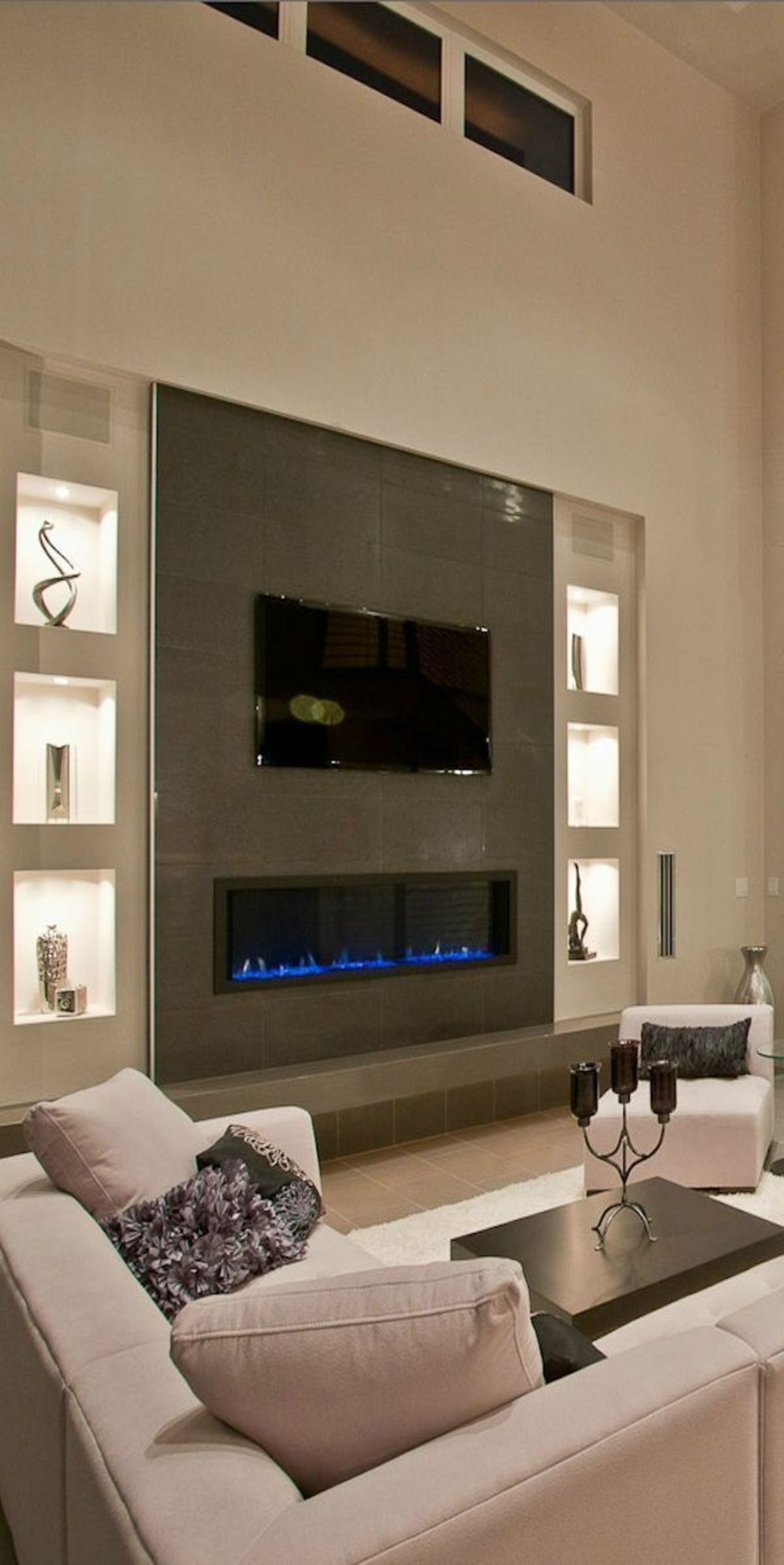 Efficient living room decoration giving exotic combination of gas burning fireplace and TV wall Image 21