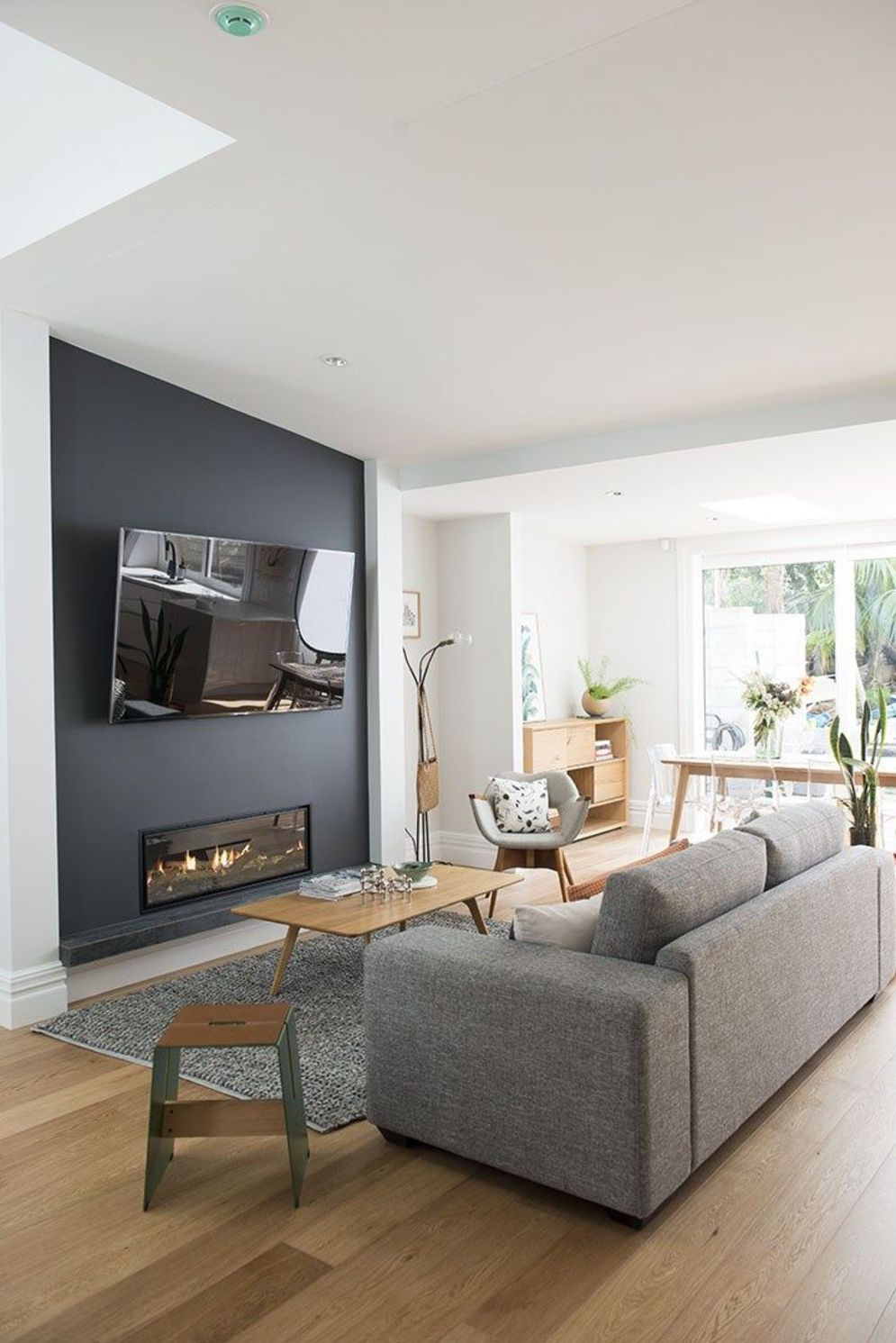 Efficient living room decoration giving exotic combination of gas burning fireplace and TV wall Image 29
