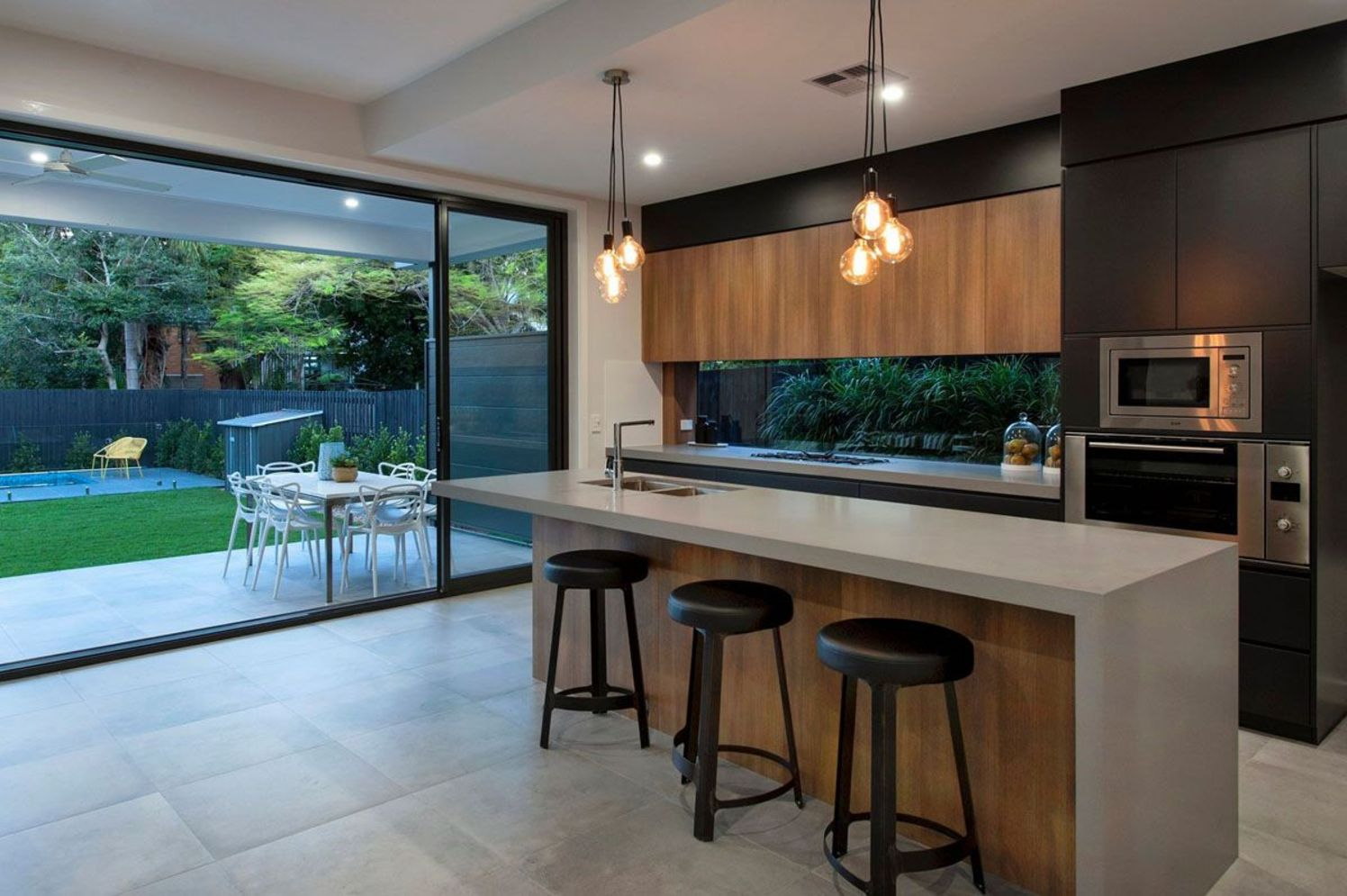 Modern kitchen updates using efficient concrete benchtops to show sturdier interior display Image 24
