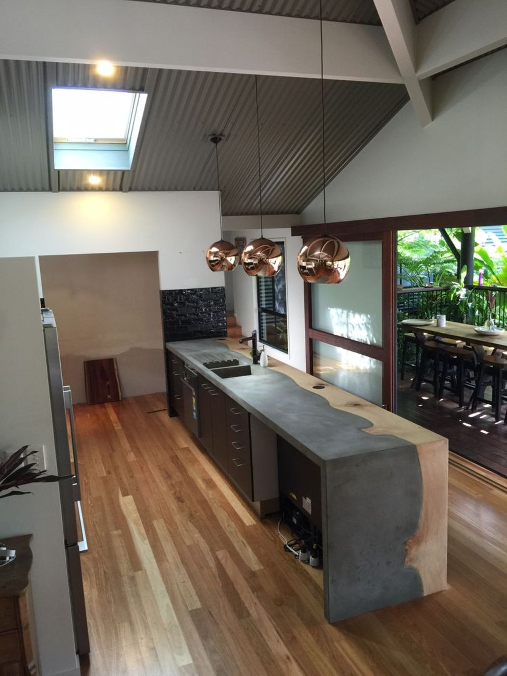 Modern kitchen updates using efficient concrete benchtops to show sturdier interior display Image 26