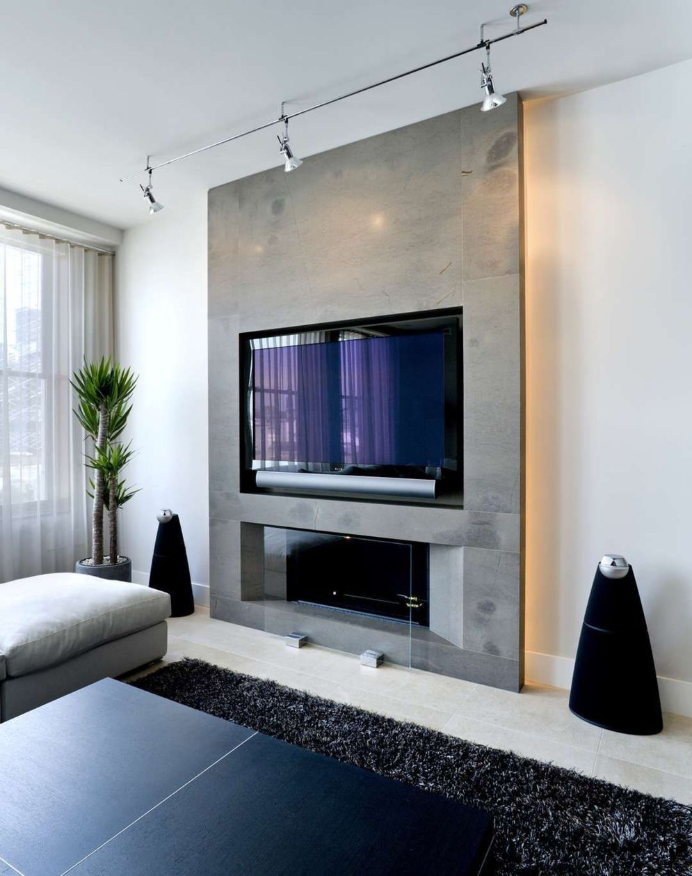 Modern living room with electric fireplace enclosed under TV wall Image 31
