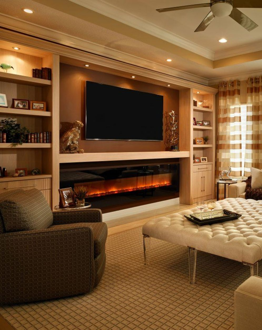 Modern living room with electric fireplace enclosed under TV wall Image 32