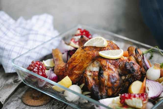 delicious roasted chicken with vegetables in glass form