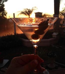 Enjoying a Martini at Sunset overlooking the ocean.