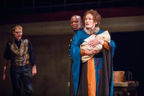 Antigonus (L. Peter Callender, center) and Paulina (Wendy Robie, right) shield Queen Hermione's child from King Leontes (Grant Goodman, left) in the Notre Dame Shakespeare Festival's 2015 production of The Winter's Tale.