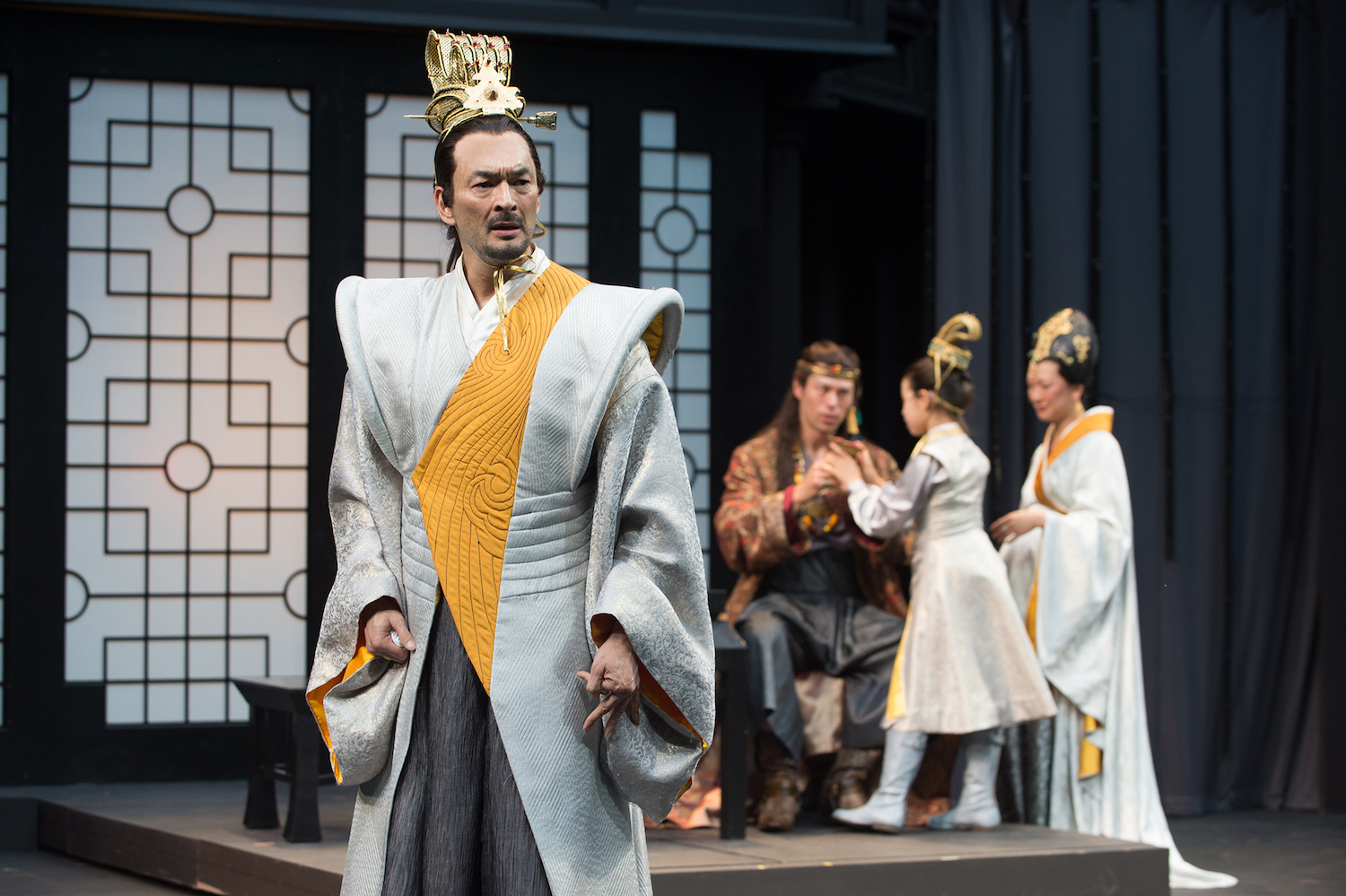 eontes (Eric Steinberg) is tortured by jealous thoughts as his friend Polixenes (James Ryen), son Mamillius (Naomi Nelson) and wife Hermione (Amy Kim Waschke) play in the background. Photo by Jenny Graham, Oregon Shakespeare Festival.