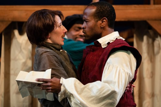 """Viola and William, characters in the Seattle Shakespeare Company's """"Shakespeare in Love,"""" look at one another in surprise."""